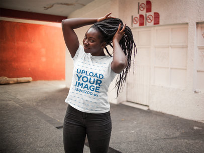 Young Black Woman with Dreadlocks Holding her Hair While Wearing a Round Neck Tee Mockup a15960