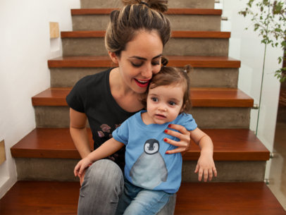 Baby and Mom Wearing Different Tshirts Mockup while at Wooden Stairways a16079