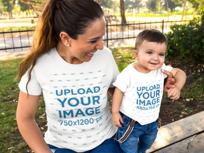 Mockup of a Baby and his Mom Wearing T-Shirts Template While at the Park a16085