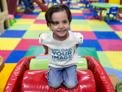 Little Kid Wearing a Round Neck Tee Mockup While at a Playground a16146