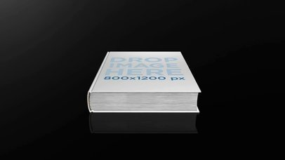 Video of a Hardcover Book Lying in a Dark Room a16105