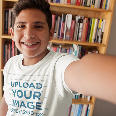 Teen Boy Taking a Selfie While Wearing a T-Shirt Template in his Room a16018