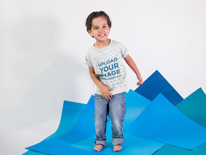 Happy Kid at a Studio Wearing a T-Shirt Mockup a16143