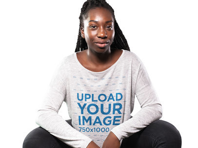 Young Black Girl With Dreadlocks Sitting Down While Wearing a Long Sleeve Bella Flowie Off Shoulder T-Shirt Mockup a16195