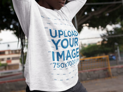Cropped Face Black Girl with Dreadlocks Wearing a Round Neck Long Sleeve Tee Mockup While Outdoors a16204