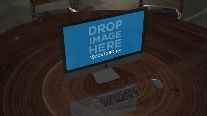 iMac Standing on Wooden Table in the Day Video a16243