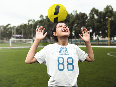 Custom Soccer Jerseys - Girl Holding a Ball on her Head a16548