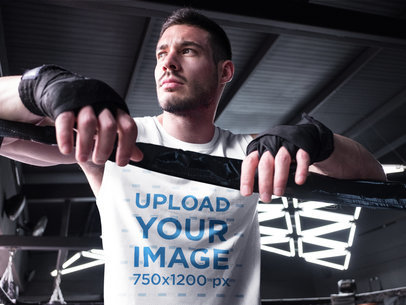 Man Leaning on the Ring While Wearing Custom Sportswear Mockup a16802