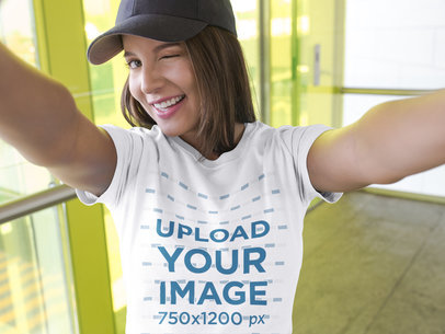 Selfie of a Beautiful Girl Wearing a T-Shirt Mockup While Smiling a16906
