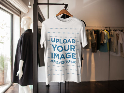 T-Shirt Mockup on a Hanger Inside a Clothes Store a16954