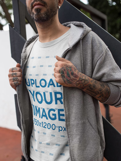 Close Up of a Tattooed Man Wearing a T-Shirt Mockup and a Sweatshirt a16985