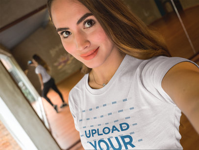 Beautiful Girl Wearing a T-Shirt Mockup While Taking a Selfie at a Dance Studio a17043