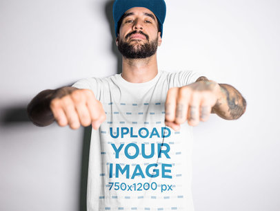 Tattooed Man Wearing a Tshirt Mockup While Showing his Knuckles a17018