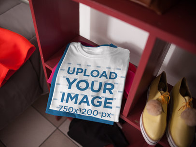 Mockup of a Folded Round Neck Tee on top of Another Tee in a Storage Unit a16940