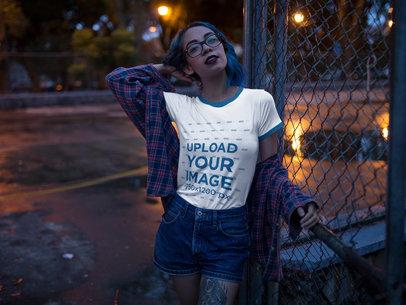 Hispanic Girl Wearing a Ringer Tee Mockup at Night a17006