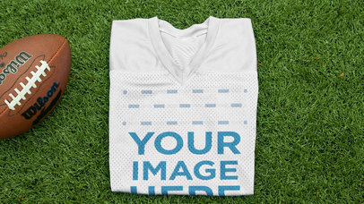 Custom Football Jerseys - Video of a Folded Jersey Near a Football at the Field a16935