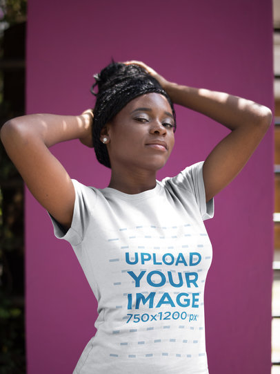 Black Girl Wearing a T-Shirt Mockup while Standing Against a Magenta Wall a17192