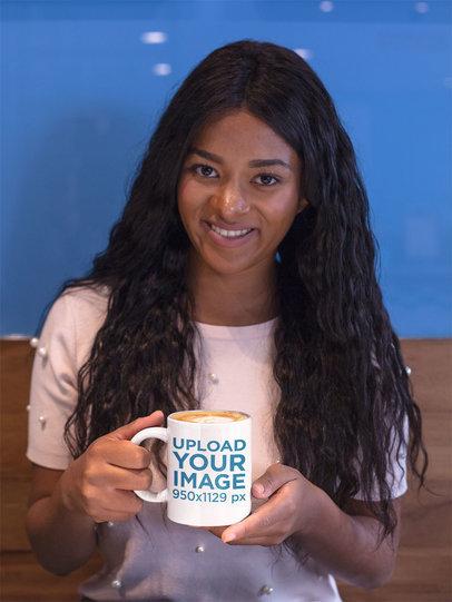 Smiling Pretty Girl Holding a Coffee Mug Mockup a17335