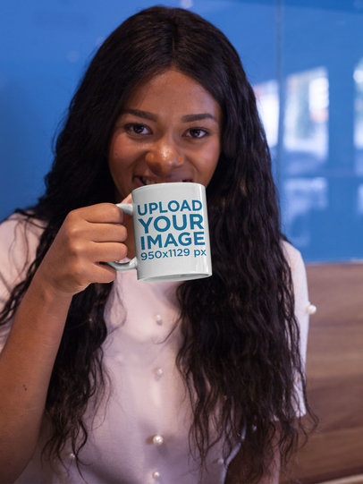 Black Girl Holding a Coffee Cup Mockup While Indoors a17339