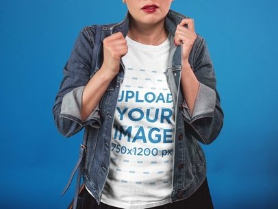 T-Shirt Mockup of a Cropped Face Girl Standing Against a Paper Background a17369