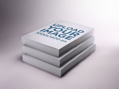 Three Books Mockup on a White Surface a17400