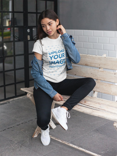Mockup of an Asian Woman Wearing a T-Shirt on a Bench a17463