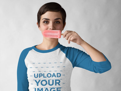 Girl Wearing a Raglan Tee Mockup while Holding a Popsicle Against her Mouth a17536