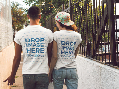 Couple Walking in a Hall Wearing Round Neck Tees Mockup from the Back a13493