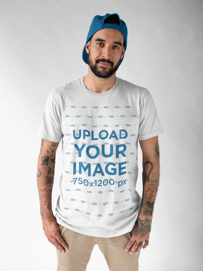Hipster Man Wearing a Round Neck Tee Mockup While in a Studio a17015