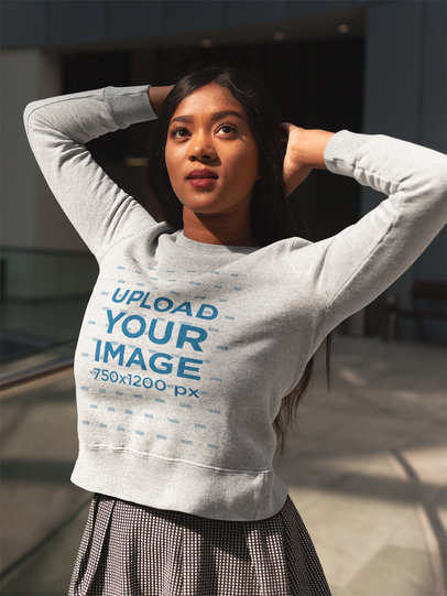 Girl Wearing a Crewneck Sweatshirt Template While Posing for the Picture a17750