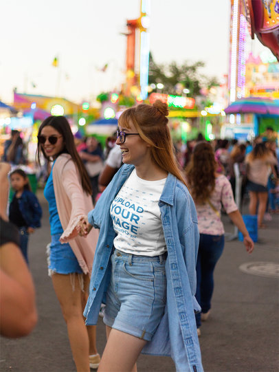 Happy Girl Wearing a Tshirt Template and a Denim Jacket at an Amusement Park a17875