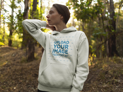 White Girl Wandering in the Woods Wearing a Pullover Hoodie Mockup a17904