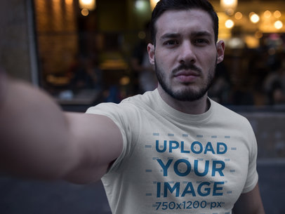 Selfie of a Buff Dude Wearing a T-Shirt Mockup a17665