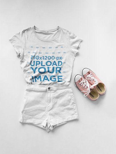 T-Shirt Mockup Lying on a White Surface Next to a Cool Outfit a17961