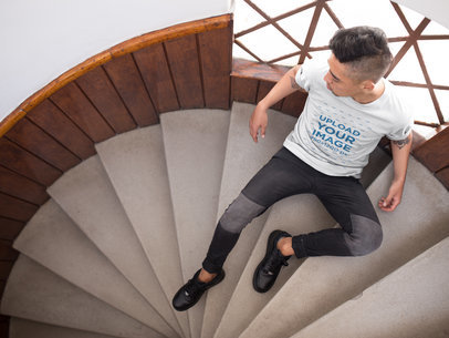 Mockup of an Asian Dude Wearing a Tshirt on Stairs from Above a17827