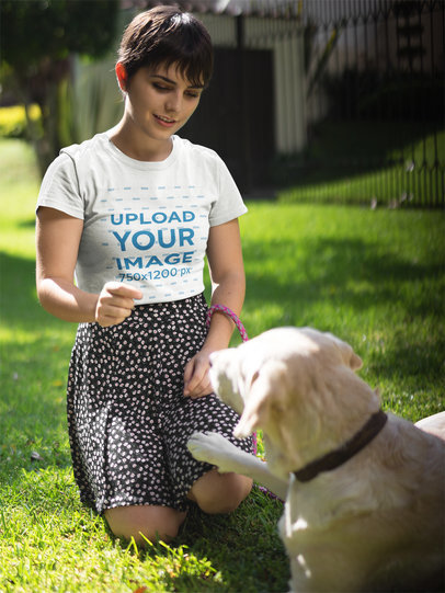 Pretty Girl Training her Dog while Wearing a Round Neck Tee Mockup a17974