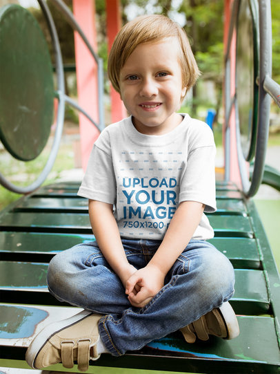 Little Blonde Kid Wearing a Tshirt Mockup at a Playground a17938