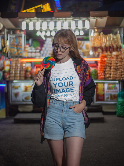 Girl with a Candy Wearing a Tshirt Mockup in the Night a17876