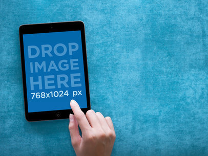 Tablet Mockup Featuring a Black iPad Mini on Vibrant Blue Backdrop