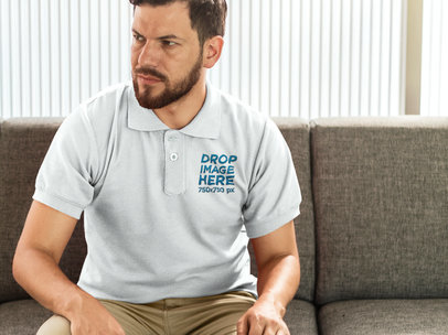 Collar Shirt Mockup of a Bearded Man Sitting on a Couch 7221a