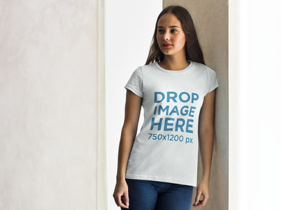T-Shirt Mockup of a Beautiful Woman Leaning on a Wall a7984