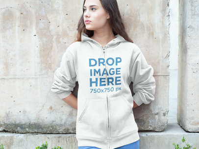 Woman Leaning Against a Cement Wall Hoodie Mockup a7883