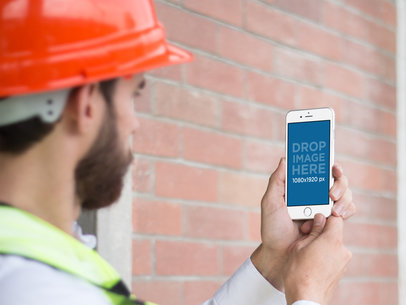 iPhone 6 Mockup Held by a Civil Engineer in Portrait Position a12415