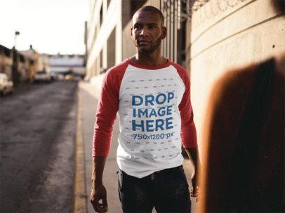 Raglan Tee Mockup of a Black Man in a Downtown Street a12560