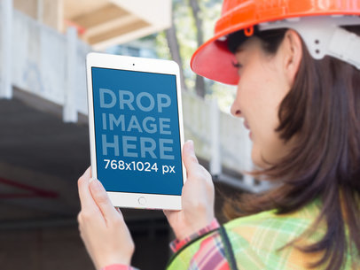 iPad Mini Mockup of a Female Construction Worker Taking a Picture a12572wide