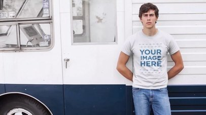 Young Man Wearing a T-Shirt Leaning Against a Van Video Mockup a12140