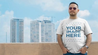 T-Shirt Video Mockup of a Plus Size Man Wearing Sunglasses On a Rooftop a12462