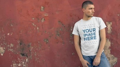 Handsome Young Man Leaning Against an Old Red Wall Wearing a Simple T-Shirt Mockup Video a12233