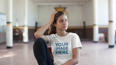 T-Shirt Video Mockup of a Woman with a Ponytail Sitting in a High School Gym a12856-121916