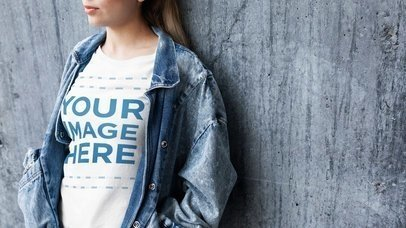 Stop Motion Video Mockup of a Beautiful Girl Wearing a Denim Jacket Against a Concrete Wall a13236